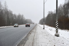Cars driving on winter asphalt road. Slippery road Stock Images