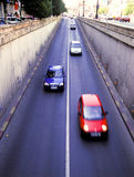 Cars entering passage Stock Photography