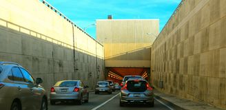 Cars Entering an Underground Tunnel Stock Image