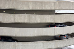 Cars on exit ramp at multiple level parking garage Stock Image