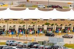 Cars exiting through a fee station at DIA Stock Photos