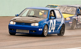 Cars fight for pole position Stock Photography