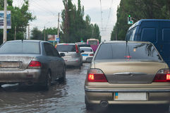 Cars on flooded road Royalty Free Stock Image