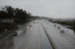 Cars on the freeway in rainy weather Royalty Free Stock Photo