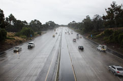 Cars on the freeway in rainy weather Royalty Free Stock Images