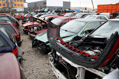 Cars in front of the scrap Royalty Free Stock Photography