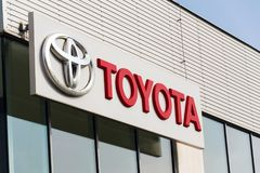 Cars in front of Toyota motor corporation dealership building Royalty Free Stock Photos