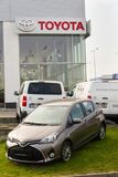 Cars in front of Toyota motor corporation dealership building Stock Images