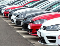Cars on Garage Forecourt. Image of a row of cars on the garage forecourt Stock Photo