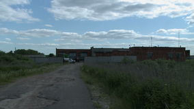 Cars in garage at summer day stock footage