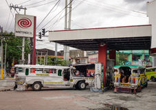 Cars at gas online station in Manila, Philippines Royalty Free Stock Photography