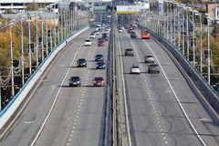 Cars go on bridge at Komsomolsky prospect. At sunny day in Moscow, Russia Stock Photography