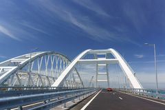 Cars go on the Crimean automobile bridge connecting the banks of the Kerch Strait. Taman and Kerch stock images