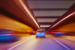 Cars go in lit tunnel Stock Images