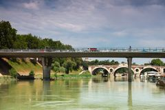 Cars go over bridge on Tiber River Stock Photos