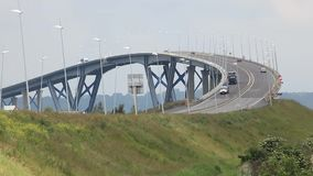Cars go over the Normandy bridge near Le Havre city stock footage