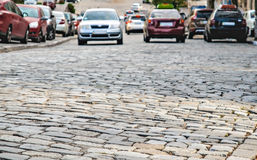 Cars go on the road cobbles Royalty Free Stock Photography