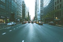 Cars Going from and Through on Road in Middle of High Rise Buildings Royalty Free Stock Images