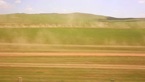 Cars going vast grassland of mongolia Stock Photos