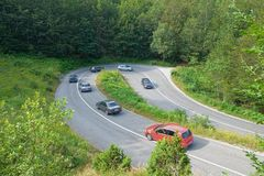 Mountain hairpin turn, Montenegro. Cars on hairpin turn mountain road in Montenegro stock images