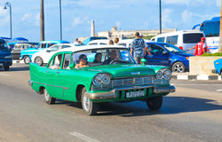 Cars of Havana, Cuba. Havana, Cuba - December 19, 2016: Tourists sightseeing in retro cars on Malecon, major avenue in Havana, Cuba Stock Photos