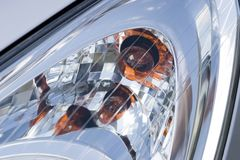Cars headlight close-up. Headlight of modern vehicle, close-up shot Stock Images