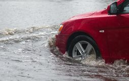 Cars in heavy rain Stock Images