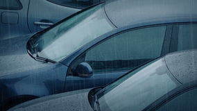 Cars In Heavy Rain. Row of parked cars in rainfall stock footage