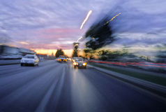 Cars in highway. Blurred highway with cars at twilight. Film scan, visible grain stock photos