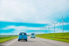 Cars on a highway. With wind turbines Royalty Free Stock Image