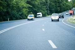 Cars on highway Stock Photos
