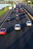 Cars on highway. Three rows of card on a busy higway, going away Royalty Free Stock Photos