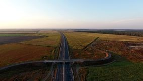 Cars on the highway aerial view stock footage