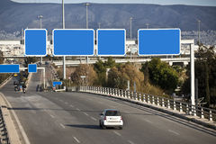 Cars on highway. With blank directional road signs Stock Photo