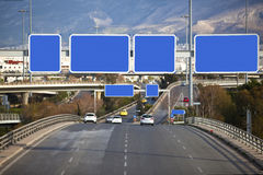 Cars on highway. With blank directional road signs Royalty Free Stock Photo