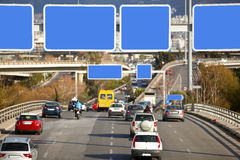Cars on highway. With blank directional road signs Royalty Free Stock Images