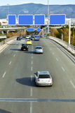 Cars on highway. With blank directional road signs Royalty Free Stock Image