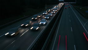 Cars on highway at dusk stock footage