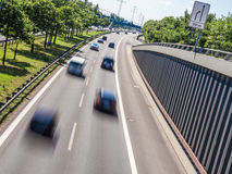 Cars on highway Stock Images