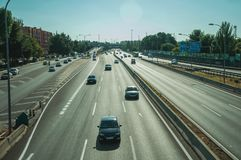 Cars on highway with heavy traffic in Madrid. Cars on multi lane highway with heavy traffic at a business district, on sunset in Madrid. Capital of Spain this royalty free stock photo