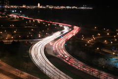 Cars on highway by lake Stock Photos