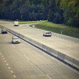 Cars on highway in traffic jam. Royalty Free Stock Images