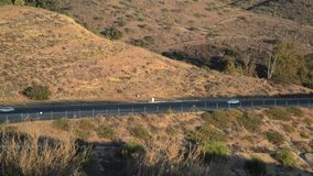 Cars on a hillside Highway stock video
