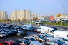 Cars on the holding yard and city view in Vilnius Royalty Free Stock Photography