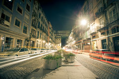 Cars, houses and lights in the street the night Porto. Toned Stock Photography