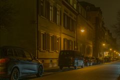 Cars in Illuminated City at Night Stock Image