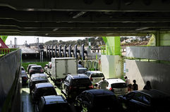 Cars and People Inside Ferry-Boat - Family Holidays. Cars inside ferry-boat with land on sight stock photo