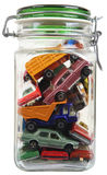 Cars in a jar. Pile of cars closed in a jar isolated on white Stock Images
