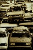 Cars in junkyard. A view of wrecked cars piled on top of each other in a junkyard.  Color modified for retro look Stock Photos