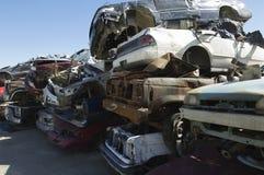 Cars In Junkyard. Stack of damaged cars in a junkyard Royalty Free Stock Image